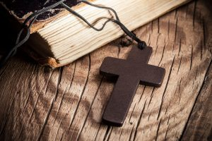Closeup of wooden Christian cross on bible